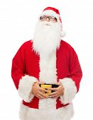 christmas, holidays and people concept - man in costume of santa claus