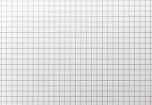 Gray line graph grid paper with slight highlight on upper left. Shot square to image dimension