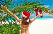 Woman in bikini on a tropical beach at christmas