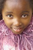 Close up of young African girl smiling
