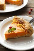 Homemade pumpkin pie on table