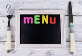 Inscription menu on chalkboard on table close-up