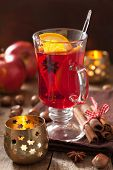 glass of mulled wine with orange and spices