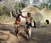 stock photo of zulu  - Zulu warriors in a traditional Zulu village in South Africa - JPG