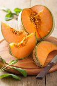 cantaloupe melon sliced on wooden background
