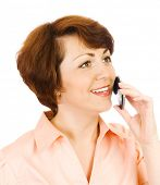 Young woman talking by mobile phone isolated