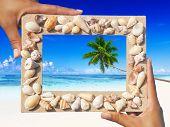 Sand frame on tropical beach.