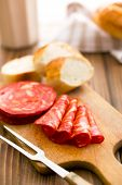 the sliced chorizo salami on cutting board