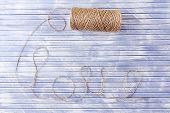 Love word formed with rope on wooden background