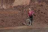 Elderly Woman Smiling On A Bike