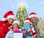 Family spending christmas in the snow.