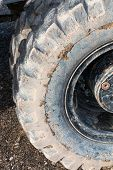 Close-up Muddy Loader Excavator Tire On The Road