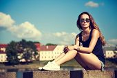 image of toned  - Trendy Hipster Girl Relaxing in the Park - JPG