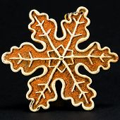 White And Brown Christmas Decoration, Snow Flake Against Black Background