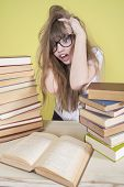 Girl Sitting With Lots Of Books And Grabs His Head..