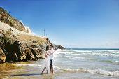 Bride And Groom Kissing On The Beach In Wedding Day In Italy