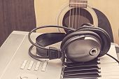 Digital Midi Keyboard, Headphones And Acoustic Guitar.