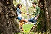 Romance Beside A Tree Trunk