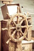 Yachting. Ship Wooden Steering Wheel. Sailboat Detail.