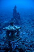 stock photo of off-shore  - An Underwater Buddhist temple located off the shore in Bali - JPG