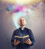 image of priest  - Priest observes universe light and god power - JPG