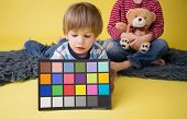 Child Holding Photography Color Checker Card