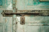 stock photo of keyhole  - Rusted keyhole on wooden door  - JPG