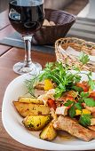 Pork And Potatoes Grilled With Fresh Vegetables