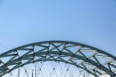 Green Steel Arch Over Denver Bridge