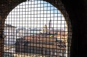 stock photo of metal grate  - Aerial view of Turin through metal grate - JPG