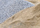 pic of sand gravel  - pile sand on cement floor used for construction - JPG