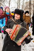 An Old Accordion Players Dressed In A Russian Ushanka.