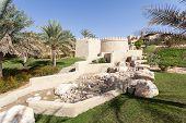 stock photo of emirates  - Desert oasis resort in the Emirate of Abu Dhabi United Arab Emirates - JPG