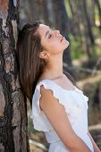 Elegant Young Woman With Eyes Closed In The Forest