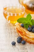 Crepes With Blueberries And Mint And A Cup Of Tea