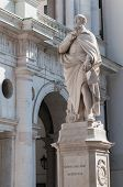 stock photo of vicenza  - The statue of the famous Italian architect of the Renaissance Andrea Palladio placed by the Basilica palladiana in Vicenza - JPG