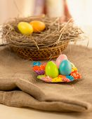 Colorful Easter Eggs Lying On Table Covered With Burlap