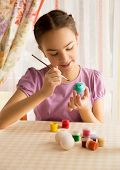 Portrait Of Cute Girl With Brush Painting Easter Eggs