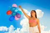 Girl Holding Balloons Sky Background