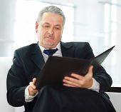 businessman sitting on the sofa in the office