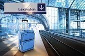 Departure For Lexington. Blue Suitcase At The Railway Station