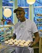 Black Man With Cupcakes On Tray