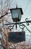 Lantern with a signboard
