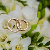 Two wedding rings in infinity sign. Love concept.