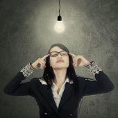 Businesswoman Finds Solution Under Lamp
