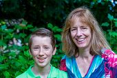 Portrait of mother and son on green background