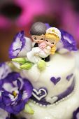 Wedding cake decorated with beautiful violet flowers