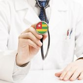 Doctor Holding Stethoscope With Flag Series - Togo