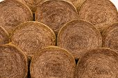 Bales, straw, beautiful sunset, scenic landscape, golden rye field with haystack,farm producing food