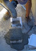 worker prepares the polystyrene mold for concrete test.